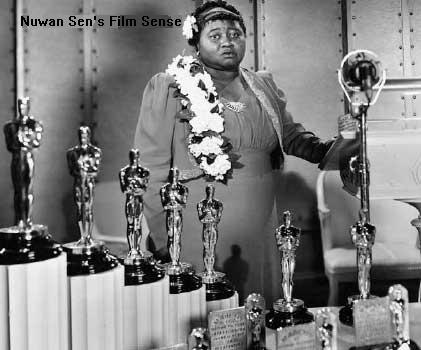 Hattie McDaniel became the first African-American ever, to be nominated and, to win an Academy Award.  She bagged the Oscar for BEST SUPPORTING ACTRESS for her incredible performance as 'Mammy' in Gone with the Wind (1939)