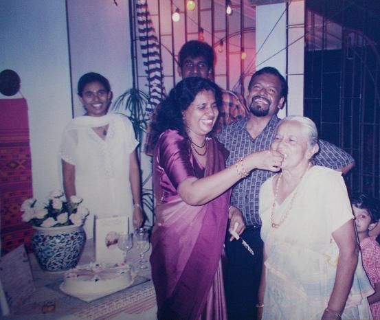At my mum's 50th Birthday party, at mums (@ 56, Siripura). Sachi & I, seen in the background. My parents & my grandmother in the foreground. Behind Attammi, is her youngest grandchild (my youngest cousin, from my mother's side).  MAY 2009