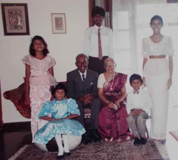 At my maternal Grandparents 45th Wedding Anniversary celebration. Atta & Attammi avec some of their grandchildren. 17 year old me, being oldest (and tallest) grandchild/grandson, is standing right behind the elderly couple. My 11 year old sister (the second oldest grandchild, and eldest granddaughter), in white, is standing, on the right side of the picture. Sachi is actually wearing our mother's bridal attire, minus the shawl/fall (July 1992)