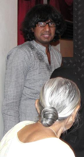 Attammi (with back turned), with me, at a function. December 2009