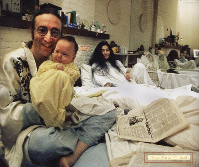 John Lennon & Yoko Ono with their newborn, Sean Ono Lennon, in 1975.